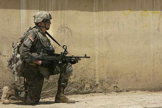 Soldier 'taking a knee' while on watch. Photo courtesy of the U.S. Army