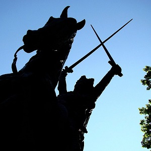 Statue holding swords