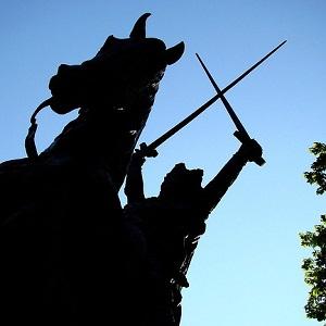Statue holding swords